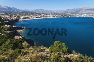 Panoramic view to the ocean bay of Albir with mountains in the background seen from natural park 'Serra Gelada' in Albir, Spain