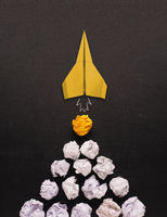 New ideas concept with crumbled paper and paper rocket