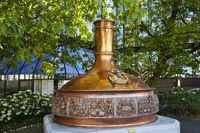 Brew kettle in front of the administration of the Warsteiner Brewery, Warstein, Germany, Europe