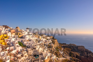 White Houses and Windmills on a Mountainside in Oia Town