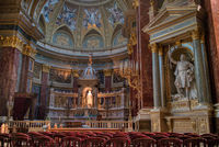 Beautiful interior of Catholic Cathedral with painting and sculptures, Budapest.