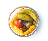 Pickled chili peppers and pickles in bowl