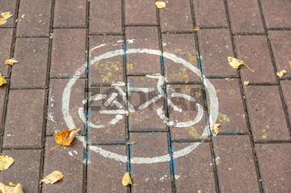 Bicycle traffic sign on stone sidewalk