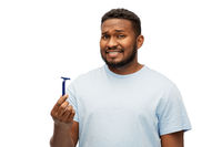 african american man holding razor blade