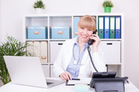 Female doctor giving advice at medical telephone hotline at home office. Flu virus disease, communic