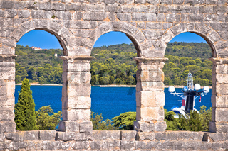 View through walls and arches of Arena Pula, Roman amphitheater in Istria
