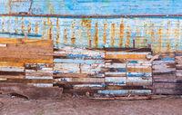 Shabby paneled wall on dirty empty beach