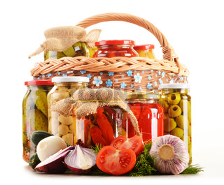 Composition with jars of pickled vegetables. Marinated food