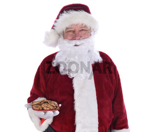 Santa Claus holding a plate full of chocolate chip cookies, isolated on white.