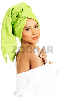 Attractive woman rubbing a body lotion on her arm. Side view.
