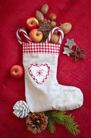 Christmas sock filled with nuts and fruit