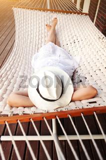 Woman lying in hammock