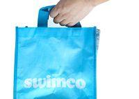 Calgary, Alberta, Canada. Oct 20, 2020. A person holding a Swimwear retailer back. Concept: bankrupt business