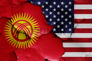 flags of Kyrgyzstan and USA painted on cracked wall
