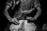 Four handed djembe drum playing
