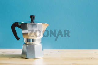 Italian metallic coffee maker Mocha coffee pot on wooden table