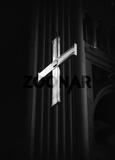 Cross in cathedral in black and white