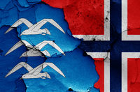 flags of Haugesund and Norway painted on cracked wall