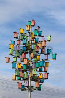 Сolorful birdhouses on a background of blue sky