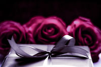 Luxury holiday silver gift box and pink roses as Christmas, Valentines Day or birthday present