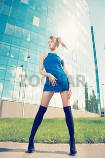 model posing outside on high heels