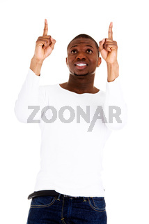 Happy young man pointing at something
