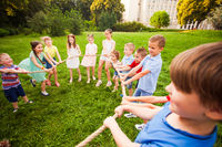 Children play with a rope in the park