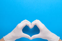 Hands In White Protective Gloves Shape Heart