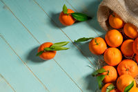 Fresh tangerines on rustic wooden table from above