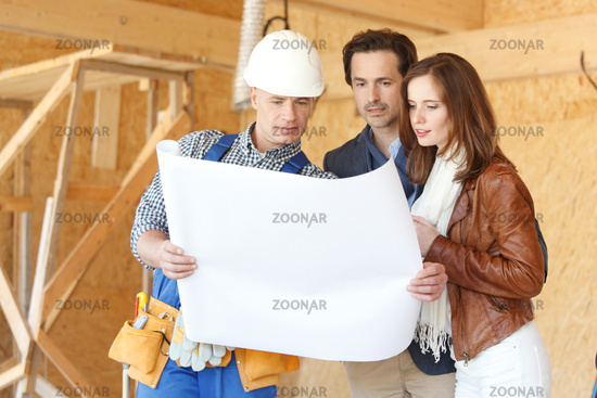 Foreman and couple with blueprint
