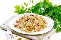 Salad of salmon and rice in plate on board