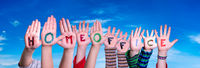 Kids Hands Holding Word Homeoffice Means Work From Home, Blue Sky