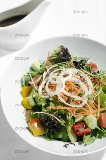 fresh organic mixed vegetable vegan Garden Salad with Vinaigrette sauce