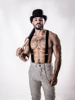 Handsome shirtless muscular man standing with bowler hat and baseball bat