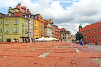 Warsaw square panorama from red brick surface. Touristic place in center of old city of Warsaw