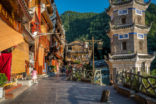 Cobblestoned pathway next to landmark Wanming Pagoda Tower in Fenghuang