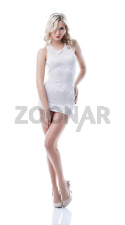 Image of elegant blonde posing in sexy short dress
