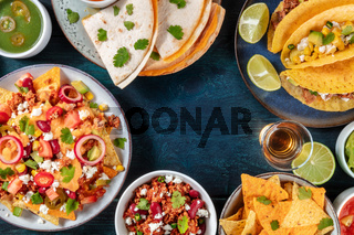 Mexican food background with a place for text. Nachos with beef, vegetable tacos, quesadillas, tequila, a design template for a menu