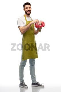 smiling male gardener with bunch of peony flowers