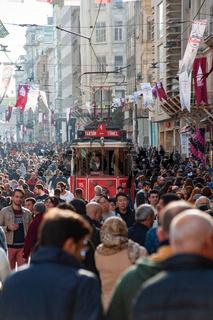 A traditional Turkish tram along a crowded Istiklal street, Istanbul. Turkey