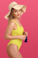 Slender attractive young blond woman in swimsuit