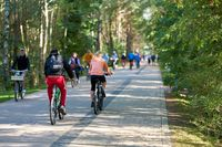 Bicyclists on the dune road between Ahlbeck in Germany and Swinoujscie in Poland