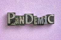 pandemic word  in gritty vintage letterpress metal types