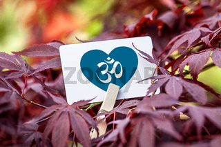 The Om Sign inside a heart