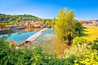 Mincio river green landscape and idyllic village of Borghetto view