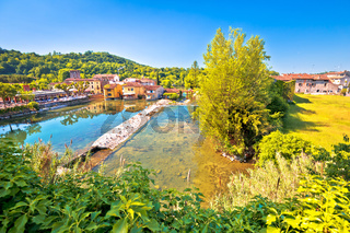 Mincio river green landscape and idyllic village of Borghetto view