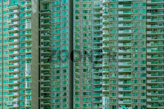 Shenzhen - green appartment block in megacity at daylight