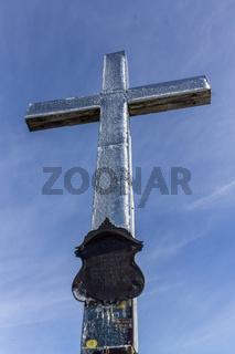 Details of frozen Summit Cross of Mount Heimgarten, 1791 m in Bavarian Prealps, located in Ohlstadt, Upper Bavaria, Germany