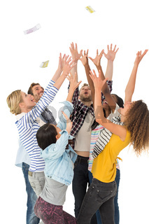 Happy group of young friends throwing money in the air