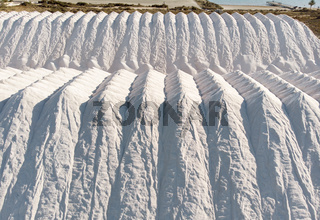 Aerial view heaps of natural salt in Santa Pola. Spain